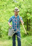 Growing plants. Mature guy cowboy hat with watering can and shovel. Arbor day. Planting trees. Commitment and. Responsibilities. Agriculture concept. Planting royalty free stock photography