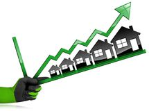 Growing Real Estate Sales - Graph with Houses Royalty Free Stock Image
