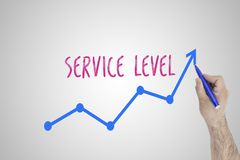 Growing service level concept on white board. Businessman draw accelerating line of improving service level against whiteboard. royalty free stock photography