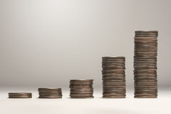 Growing Stack of Coins Stock Photo