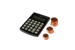 Growing stack of coins and calculator on white background. Growing stack of coins and calculator Royalty Free Stock Images