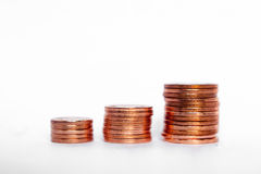 Growing stack of coins money value. Pile of coins and a coin stack between Royalty Free Stock Image