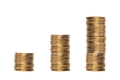 Growing stack of coins money value. Pile of coins and a coin stack between Stock Images