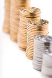 Growing stacks of coins. Gold coins on white background Stock Images