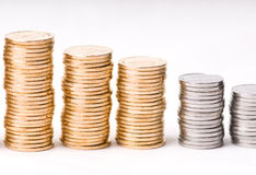 Growing stacks of coins. Gold coins on white background Stock Photo