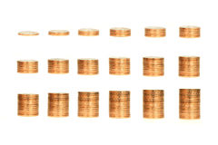 Growing Stacks of Gold Coins with White Background Stock Photos