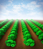 Growing success. And investing for growth with profit and success represented by green gears and cogs as crops on an agricultural farm land showing the concept Stock Image
