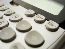Growing taxes. Calculator details. shallow DOF. focus on tax+ button stock images