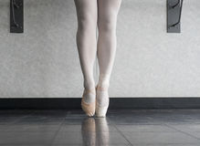 Growing Up Ballet Dancer. A ballet dancer in both her canvas soft sole ballet shoes, and a pointe shoe Royalty Free Stock Photography