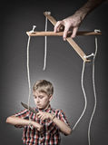 Growing-up concept. Boy cut the manipulation links concept stock photos