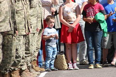 Growing up. Little boy with soldiers , watching the speech of President of Ukraine Royalty Free Stock Images