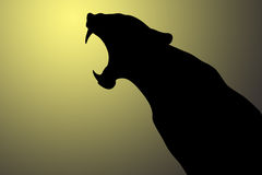 Growling panther. Black silhouette on a sunrise background Stock Images