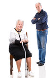 A grown son with his aging mom. On a white background royalty free stock photo