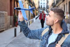 Grown up man playing an airplane toy.  royalty free stock photo