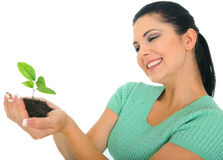 Growth. Happy young woman holding new life in form of plant stock images