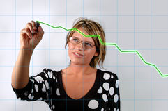 Growth. Attractive Young woman with electronic pen charting growth Stock Image