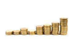 Growth. Graph made using coins describing growth Stock Photos
