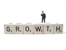Growth. A manager staring at the word growth Stock Photo