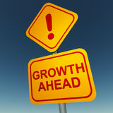 Growth ahead. Signboard in yellow and red text saying growth ahead against a clear blue sky Stock Photos