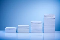 Growth in business. Represented by paper piles incrementing in size Stock Images