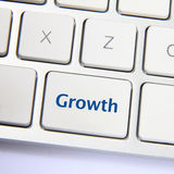 Growth button. Photo of growth button on the white keyboard Stock Photo