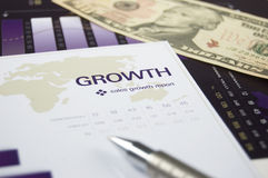 Growth Chart. Image depicting financial growth with data sheets and US Dollar. Focus on the word growth stock image