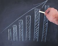 Growth chart on the board stock photography