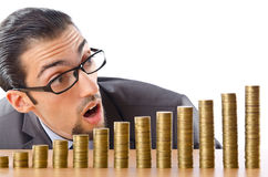Growth concept - coins and businessman Royalty Free Stock Photo