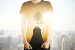Growth concept. Man with abstract tree image on shirt. Growth concept. City background. Double exposure Stock Photos