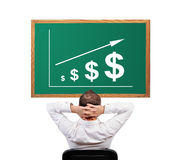 Growth dollar on desk Royalty Free Stock Image