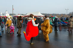 Growth dolls at Shrovetide festivities, Gomel, Belarus. GOMEL, BELARUS - FEBRUARY 21, 2015: Growth dolls at Shrovetide festivities. Unidentified people visit Royalty Free Stock Images