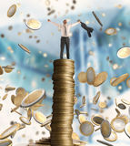 Growth exponential gain. Happy businessman exults over a stack of golden coins Royalty Free Stock Photography