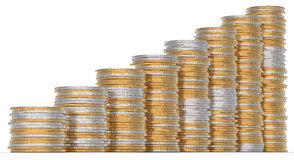 Growth: golden and silver coins stacks. Over white Royalty Free Stock Images
