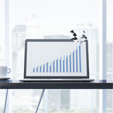Growth graph breaks laptop display. Royalty Free Stock Images
