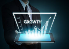 Growth graph on tablet technology Royalty Free Stock Photo