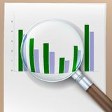 Growth histogram behind a magnifying glass. Stock Photography