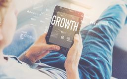 Growth with man using a tablet royalty free stock images