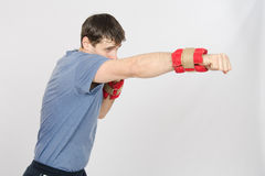 Growth portrait of boxer worked blows with weighting Royalty Free Stock Photo