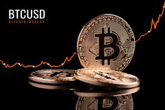 Growth rate cryptocurrency. The growth of Bitcoin on the stock exchange. Bitcoin exchange rate is growing on the stock against the dollar. Conceptual shot. The stock photo