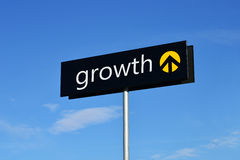 Growth street sign. Street sign with upward arrow reading growth Royalty Free Stock Images