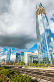 Growth of a sustainable city. Big skyscraper under construction with cloud reflections, representing a sustainable city. Beautiful cloudscape in the background Stock Photography