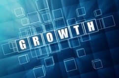 Growth in blue glass cubes Stock Photo
