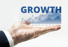 Growth word with business financial growing graph chart. Background on male hand.For business growth and financial success concept ideas Royalty Free Stock Photography