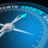 Growth word on compass Royalty Free Stock Images