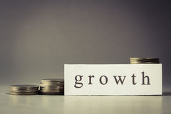 Growth and coins Stock Photography