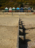 Groyne and beach huts Stock Photo