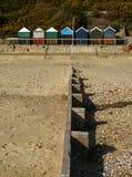 Groyne and beach huts Stock Photo