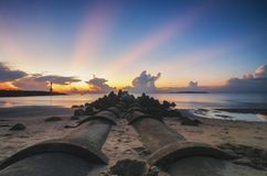 Groyne and beautiful sea view scenery over stunning sunrise stock photos