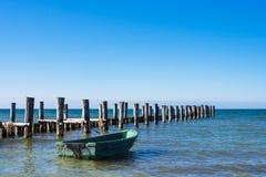 Groyne and fishing boat on the Baltic Sea coast Stock Photography