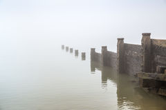 Groyne in the fog. Stock Photo